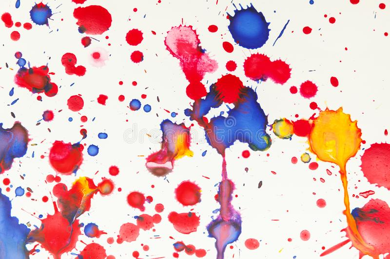 Colorful paint splashes artistic pattern, top view. Colorful paint splashes artistic pattern over white paper, background photo texture, top view royalty free stock photo