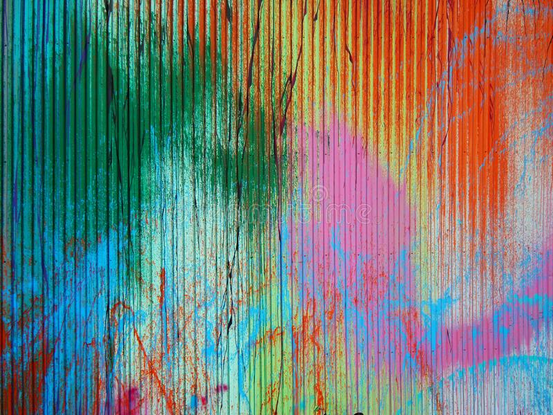 Colorful paint splashes. On metal profile wall royalty free stock images