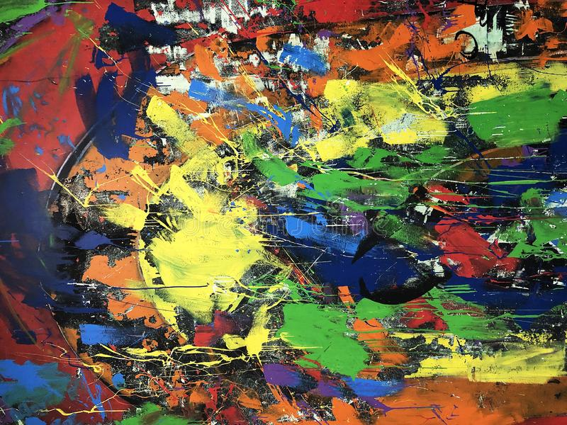 Colorful paint splashes. On the wall stock image