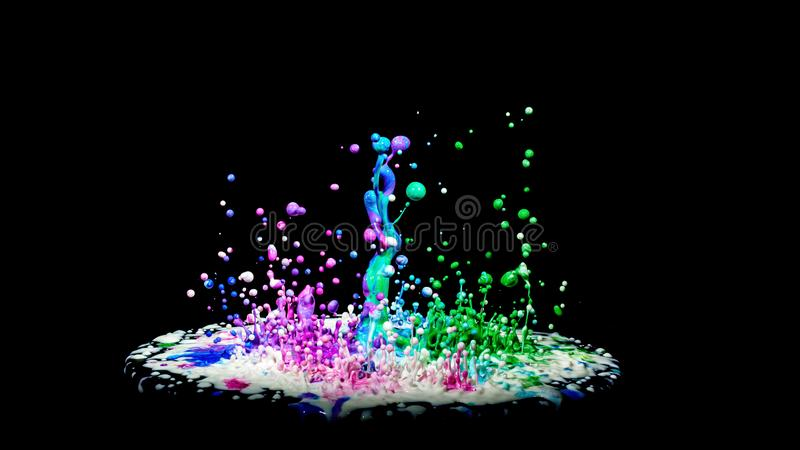 Colorful paint splashing on audio speaker isolated on black background royalty free stock photo