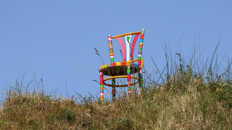 Colorful painted chair on the top of a dune stock image
