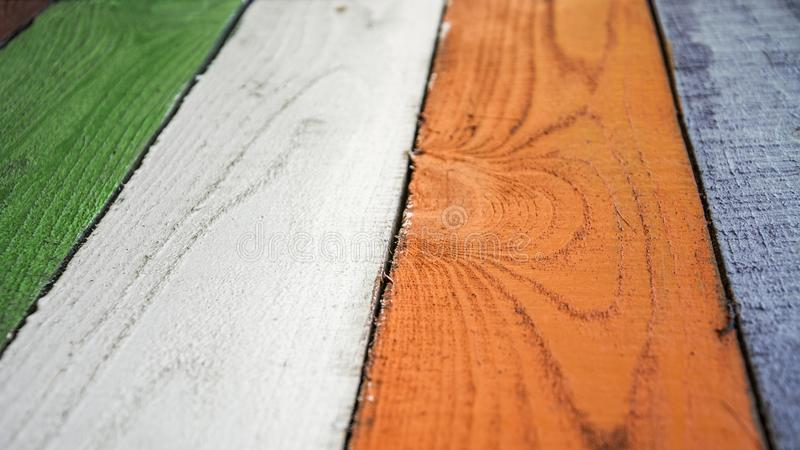 Colorful painted with colored paints the background from wooden boards royalty free stock photos