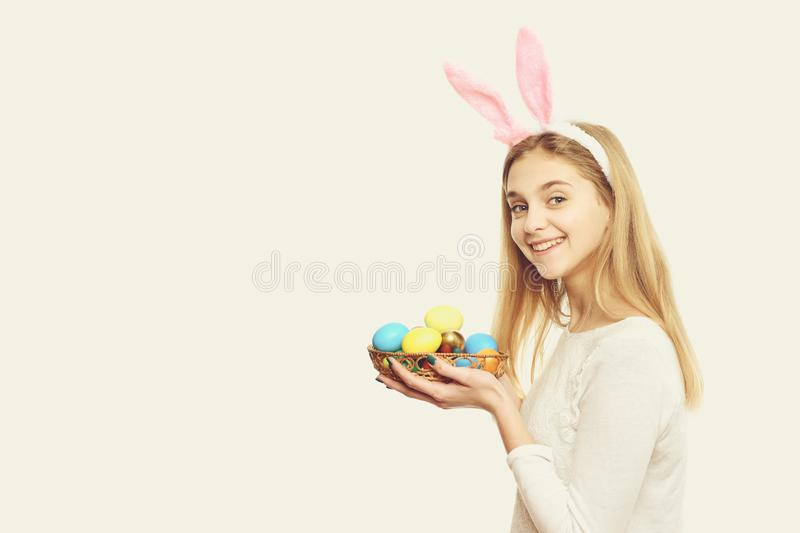 Happy easter girl in bunny ears with colorful painted eggs stock images