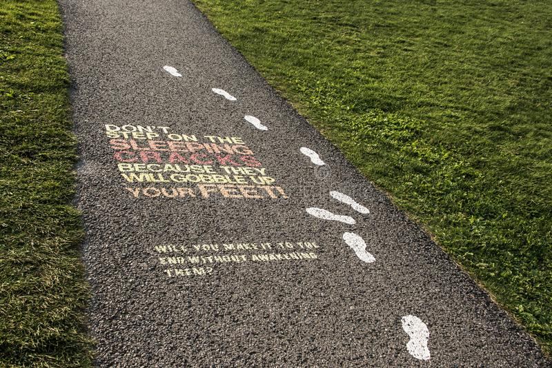 Colorful painted museum sign on asphalt pavement plaines d`Abraham Road to Museum at Citadelle of Quebec City,Canada. Colorful painted museum sign on asphalt royalty free stock images