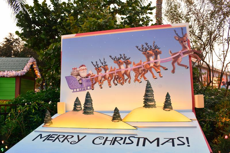 Colorful painting of Santa Claus, reindeer and Merry Christmas letters in International Drive area. royalty free stock photography