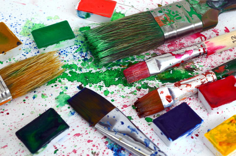 Colorful paints and artist brushes. stock images