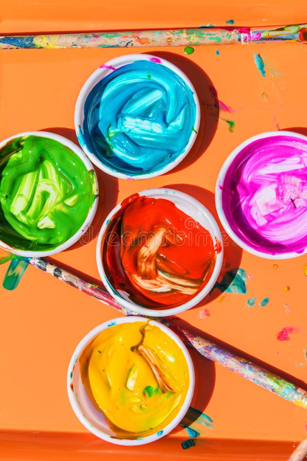 Colorful Paints Sit In Bowls For Kids To Paint With royalty free stock photos