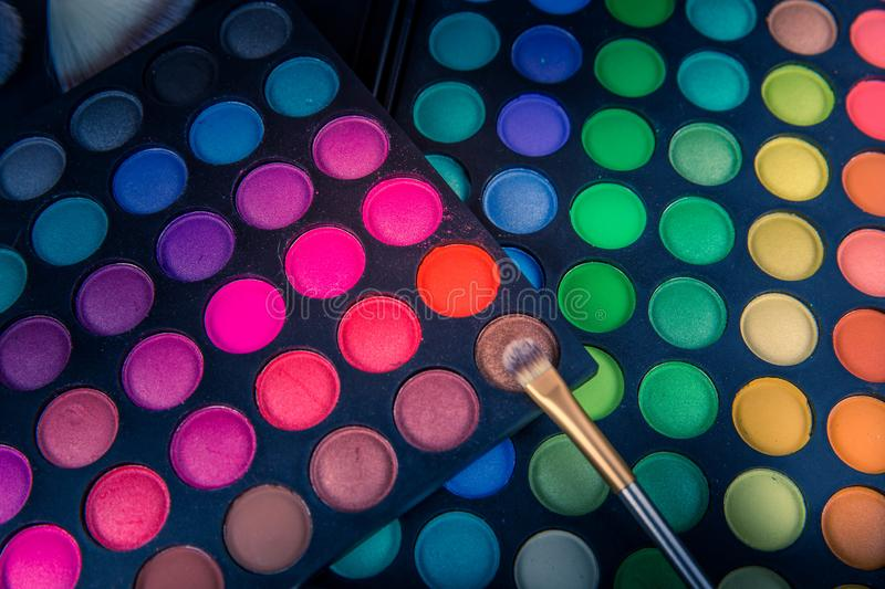 Colorful palette of cosmetic make-up eye shadows with bush royalty free stock images