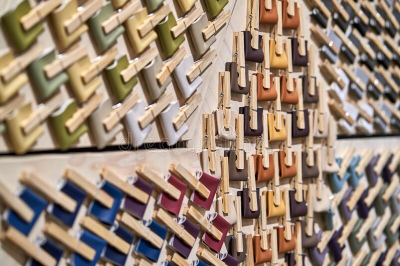 Colorful palette of textile swatches on wooden wall royalty free stock photos