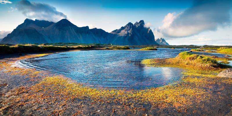 Colorful panorama of the Stokksnes headland. On southeastern Icelandic coast. Iceland, Europe. Artistic style post processed photo stock photography