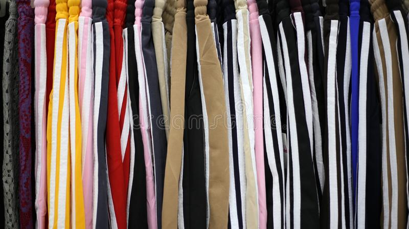 Colorful pants in one department store in the heart of the cityColorful pants are the fashion of East Asian people who wear bright. Colored pants royalty free stock photos