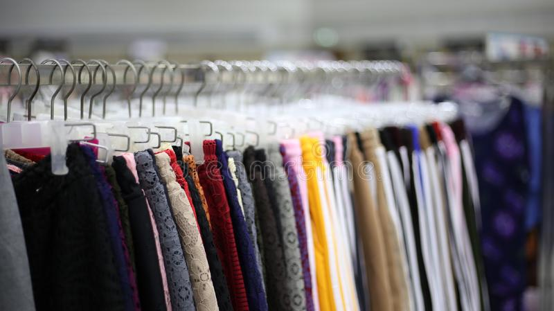 Colorful pants in one department store in the heart of the cityColorful pants are the fashion of East Asian people who wear bright. Colored pants stock images
