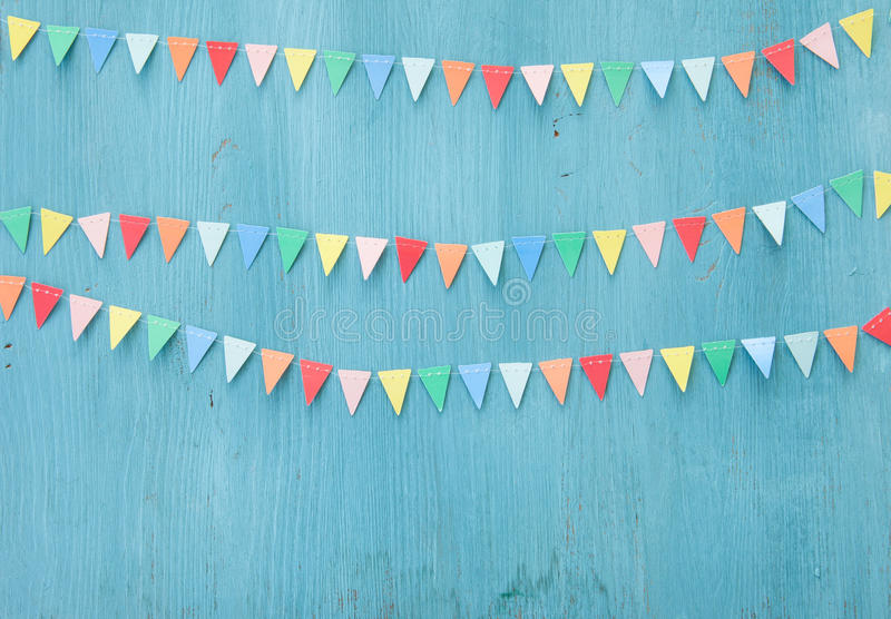Colorful paper bunting. On rustic wooden background royalty free stock photos
