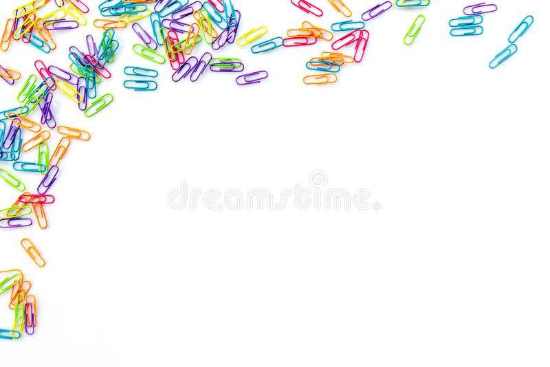Colorful paper clips isolated on white with copy space. Back to school concept stock images
