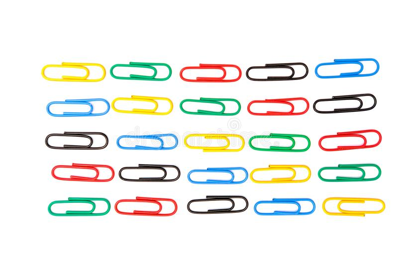 Colorful paper clips in white background. A lot of paper clips in the floor with white background royalty free stock photography