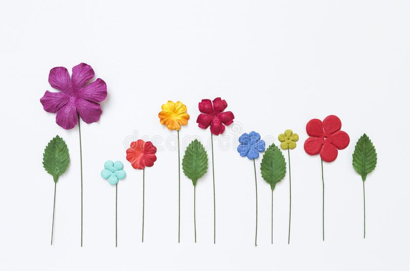 Colorful paper flower background, card background design. Paper flower garden on white paper texture background stock photos