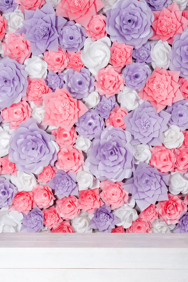 Colorful paper flowers background. Floral backdrop with handmade roses for wedding day or birthday. Colorful paper flowers background. Floral backdrop with royalty free stock photo
