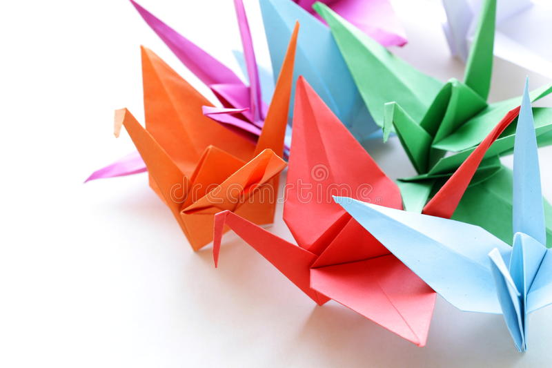 Colorful paper origami birds. On a white background stock image