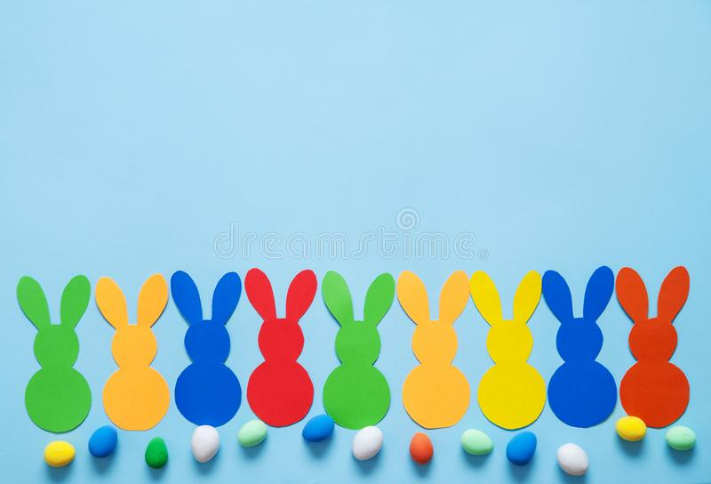 Colorful paper`s rabbits on purple background. Colorful paper`s rabbits on purle background. Happy Easter royalty free stock photo