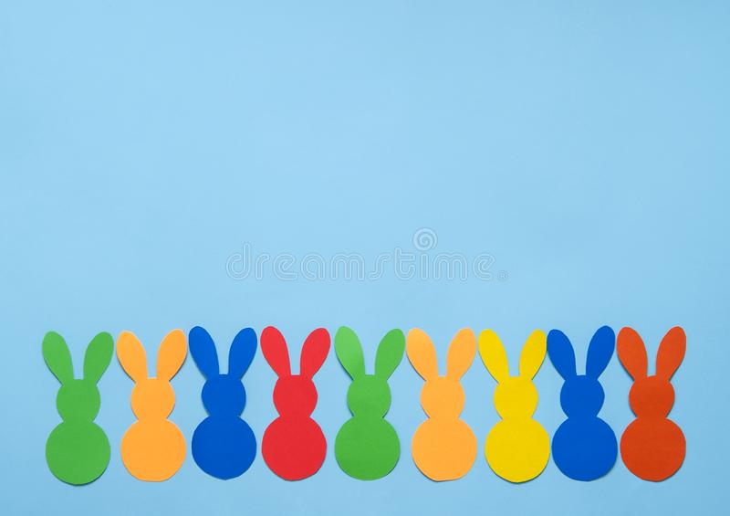 Colorful paper`s rabbits on purple background. Colorful paper`s rabbits on purle background. Happy Easter stock photography