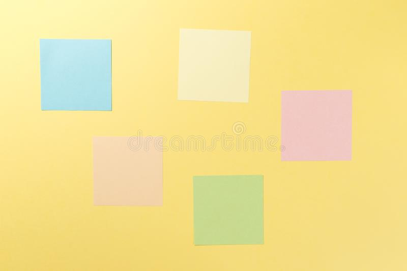 Colorful paper stickers on yellow background stock photo