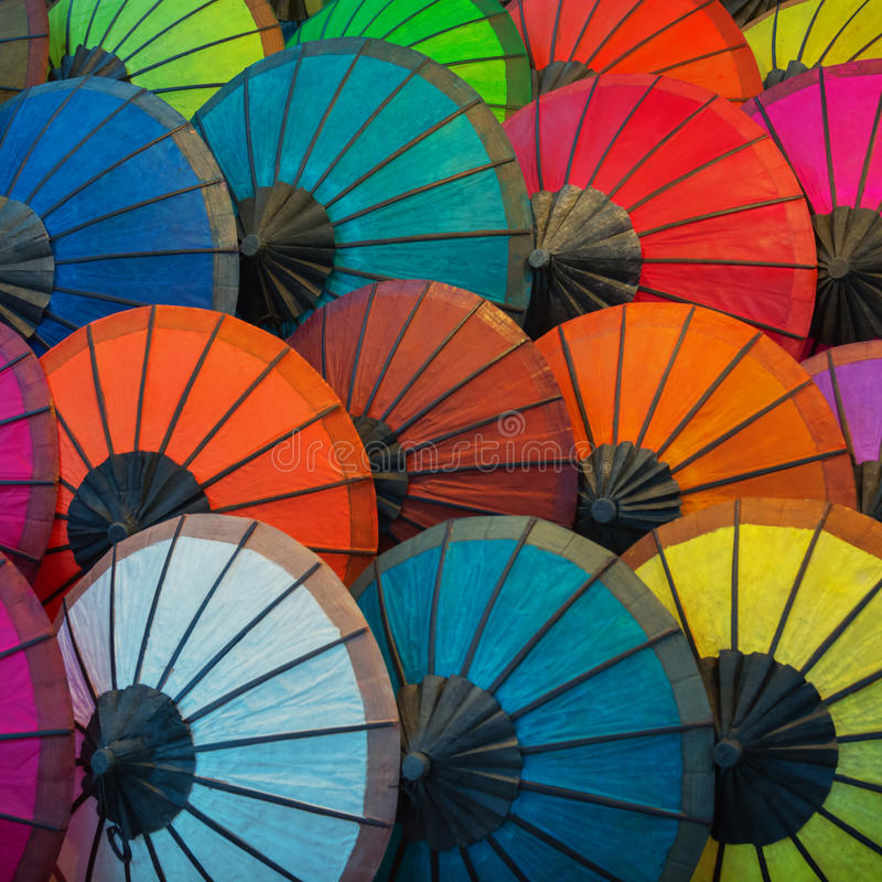 Colorful paper umbrellas on the market. Laos stock photos