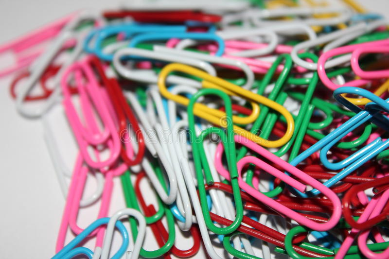 Colorful paperclips royalty free stock images