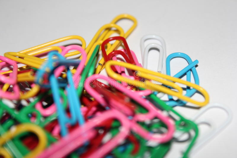 Colorful paperclips stock images