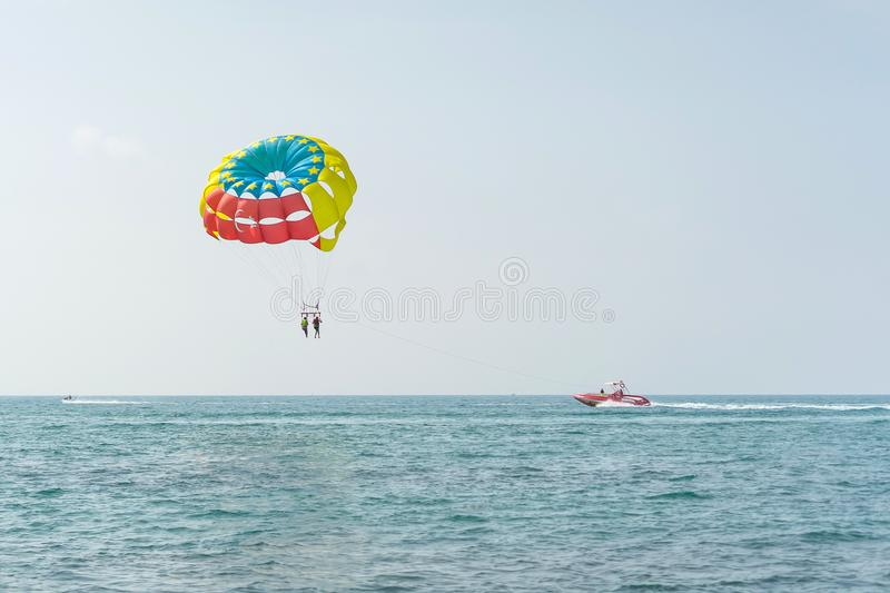 Colorful parasail wing pulled by a boat in the sea water - Alanya, Turkey royalty free stock image