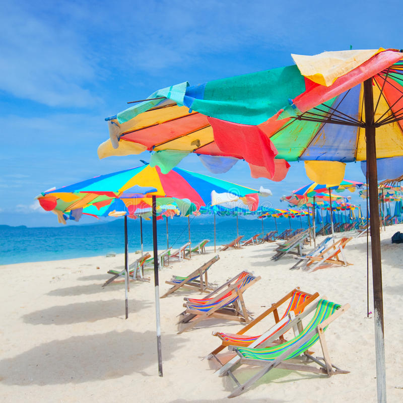 Colorful parasols on a tropical island royalty free stock image