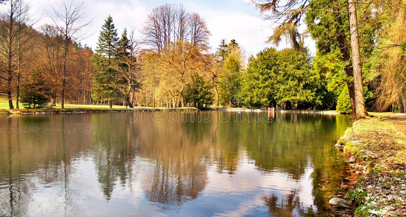 Colorful park and lake in autumn