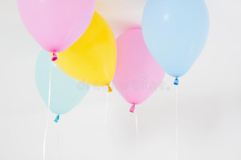 Colorful party balloons background. Isolated on white. Copy space stock photos