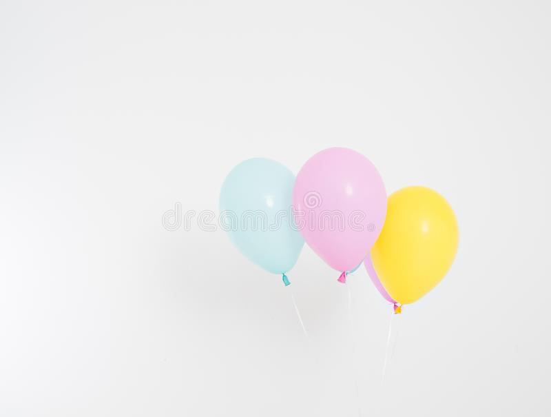 Colorful party balloons background. Isolated on white. Copy space royalty free stock photo
