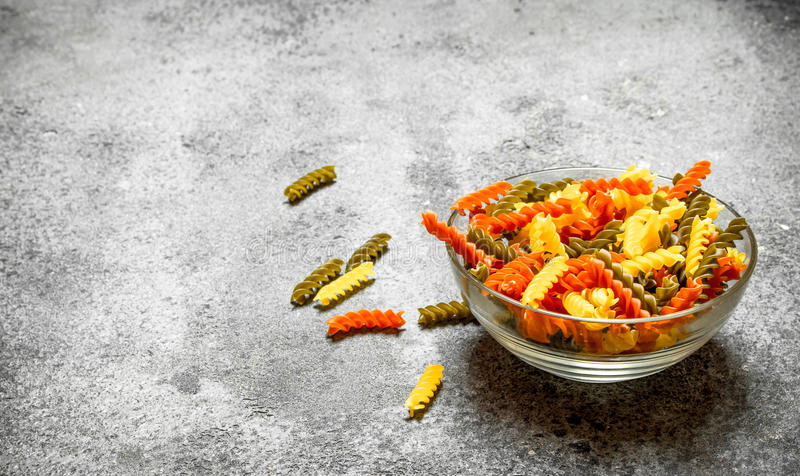 Colorful pasta in bowl. stock image