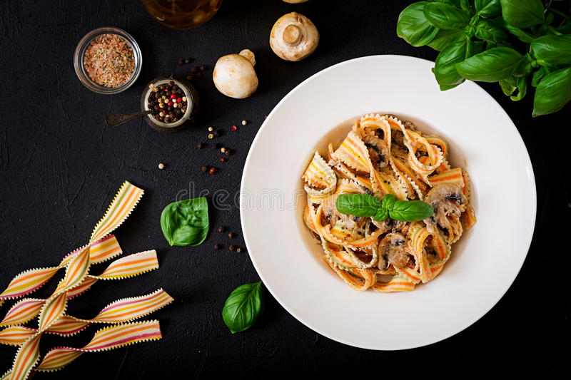 Colorful Pasta pappardelle with mushrooms in cream sauce. Flat lay. Top view stock photos