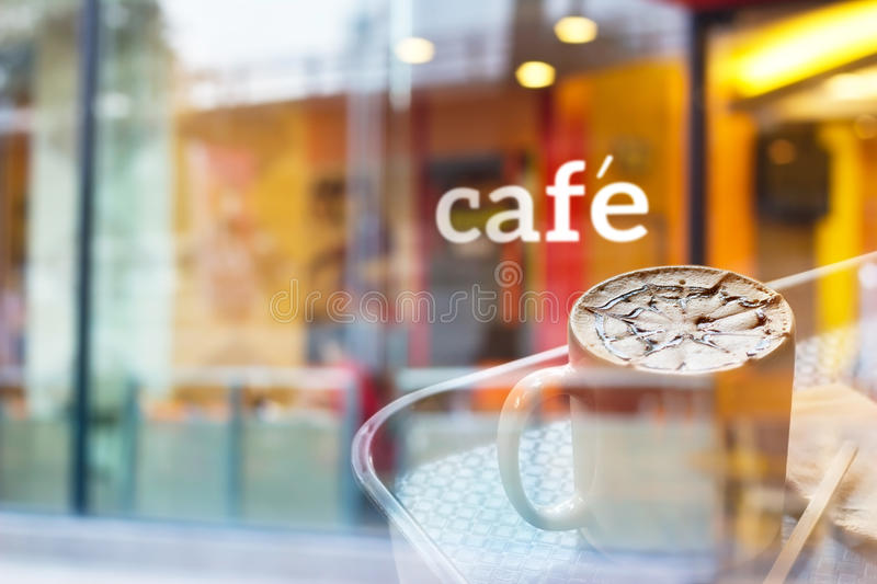 Colorful and pastel coffee shop and text cafe in front of mirror, soft and blur concept. Colorful and pastel coffee shop and text cafe in front of mirror stock image