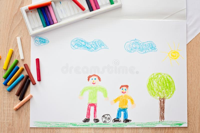Colorful pastel oil crayons and children`s drawing royalty free stock photography