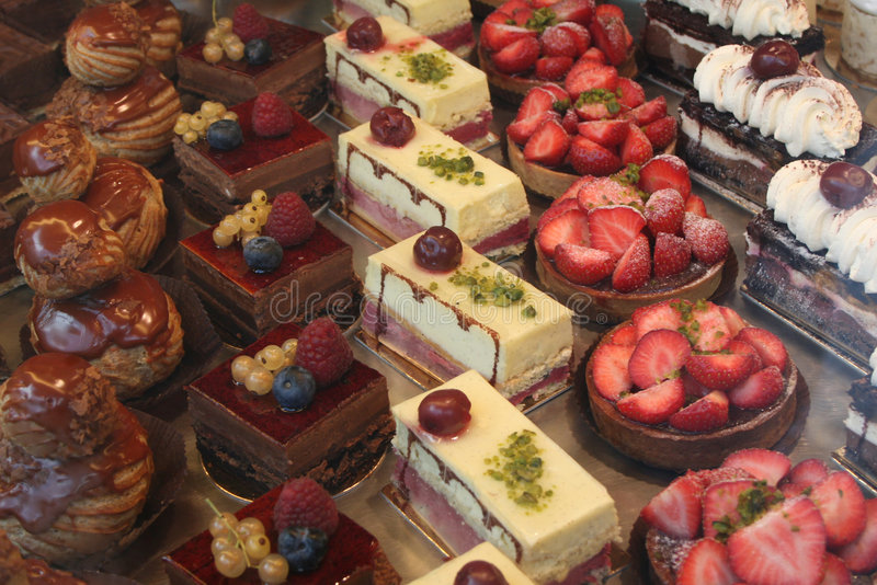 Colorful Pastry Display. Colorful display of pastries topped with fruits stock photo