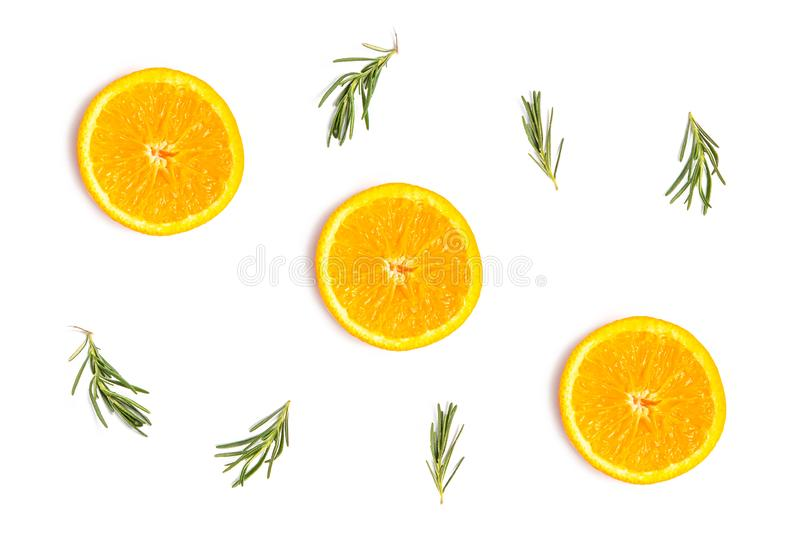 Summer fruit pattern. Colorful pattern of fresh summer orange slices with rosemary sprigs on white background.  Top view fruit fruits yellow flat lay tropical royalty free stock photography