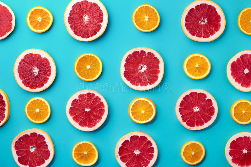 Colorful pattern of grapefruit and orange slices royalty free stock image