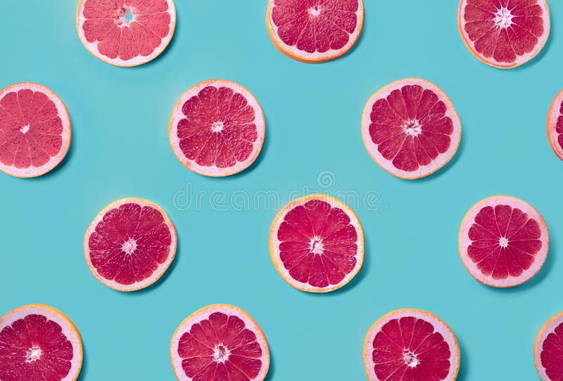 Colorful pattern of grapefruit slices royalty free stock photos