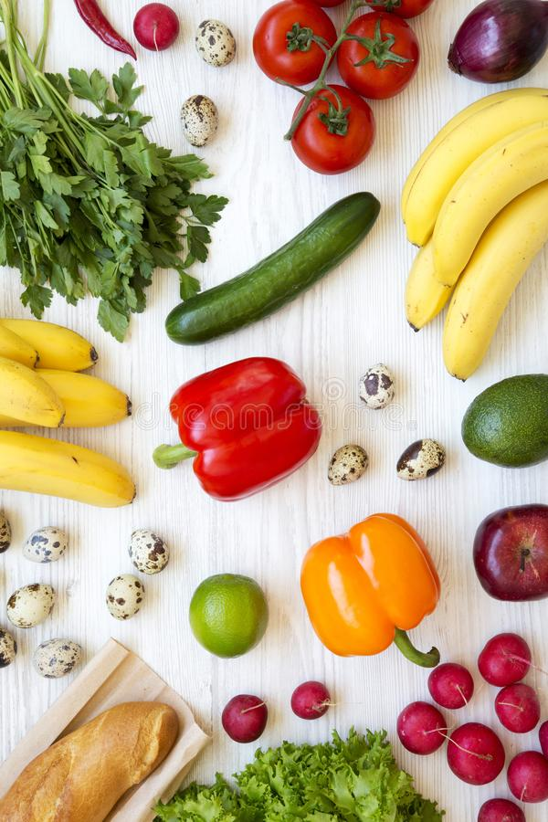 Colorful pattern of health food on a white wooden surface, overhead. Healthy eating. Top view. From above. Flat lay royalty free stock photos