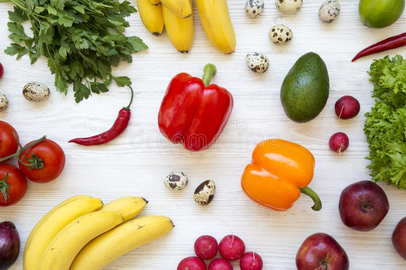 Colorful pattern of health food on a white wooden table. Healthy eating. Top view. royalty free stock images