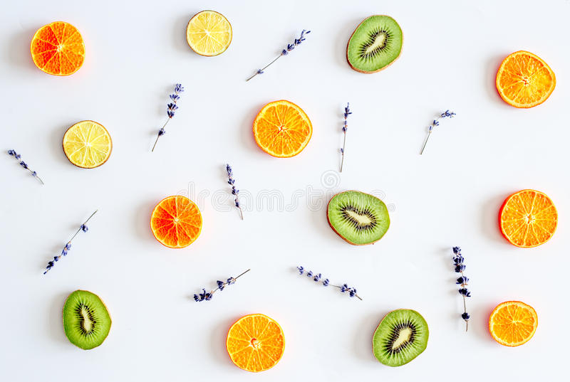 Colorful pattern made of fruits on white background.  stock photography