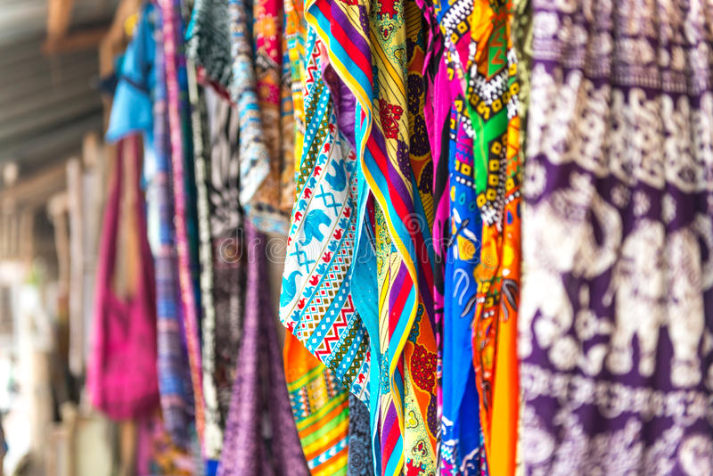 Colorful patterned shawls and fabric at Zanzibar market royalty free stock photography