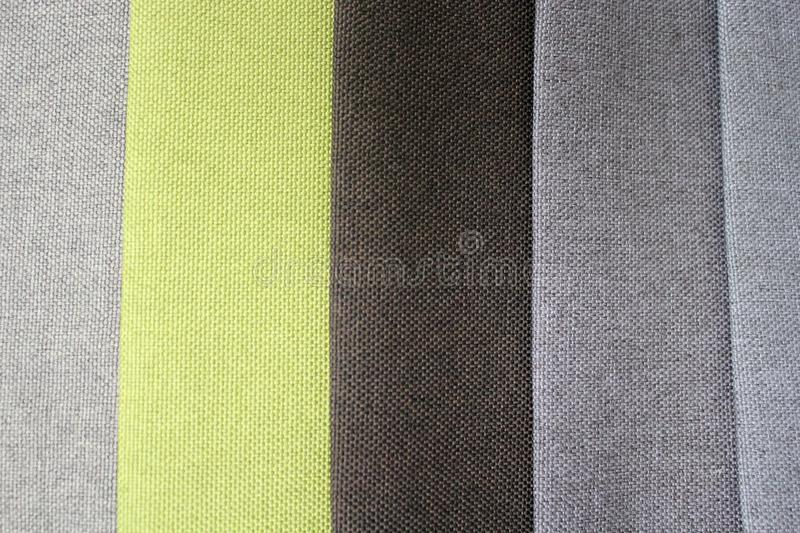 Colorful patterns of upholstery fabric. Close-up of samples of furniture fabric. Multicolored soft textile. Furniture industry. Background texture royalty free stock photos
