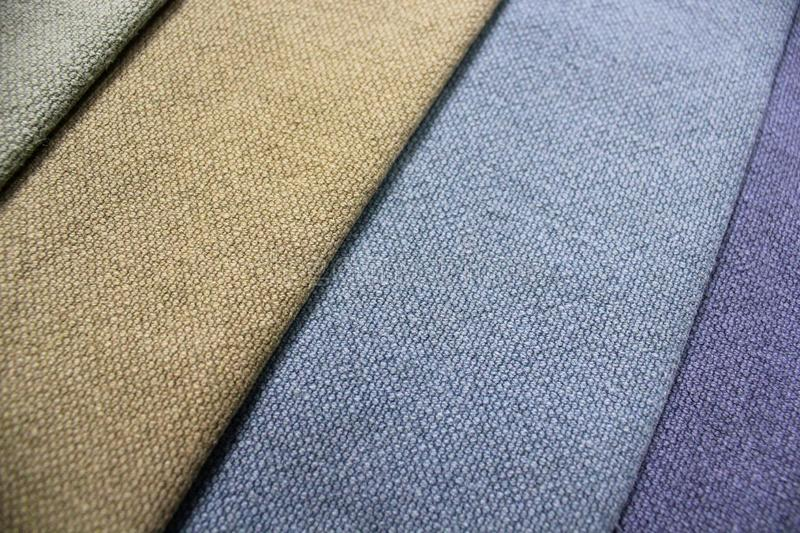Colorful patterns of upholstery fabric. Close-up of samples of furniture fabric. Multicolored soft textile. Furniture industry. Background texture stock photography