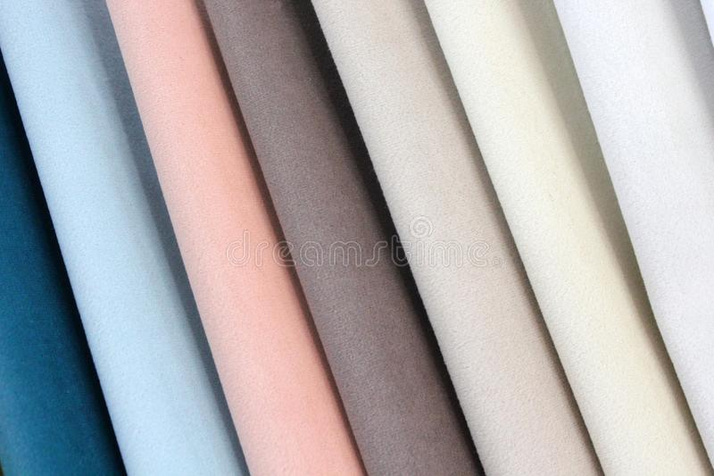Colorful patterns of upholstery fabric. Close-up of samples of furniture fabric. Multicolored soft velour. Furniture industry. Bac. Kground texture. Fabric stock photography