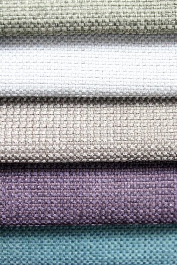 Colorful patterns of upholstery fabric. Close-up of samples of furniture fabric. Multicolored soft velour. Furniture industry. Bac. Kground texture. Fabric stock photos