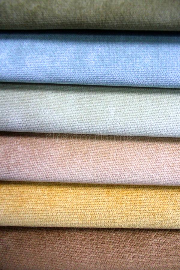 Colorful patterns of upholstery fabric. Close-up of samples of furniture fabric. Multicolored soft textile. Furniture industry. stock photography